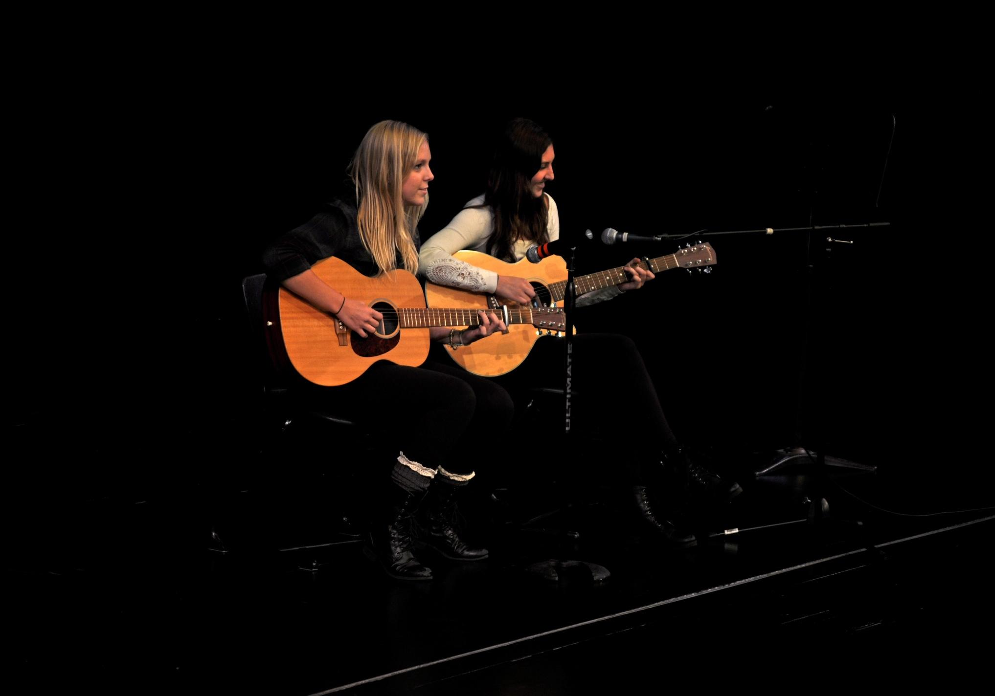 Ellie Andrews and Emily Savidge '14 perform at the first Coffee House of the year