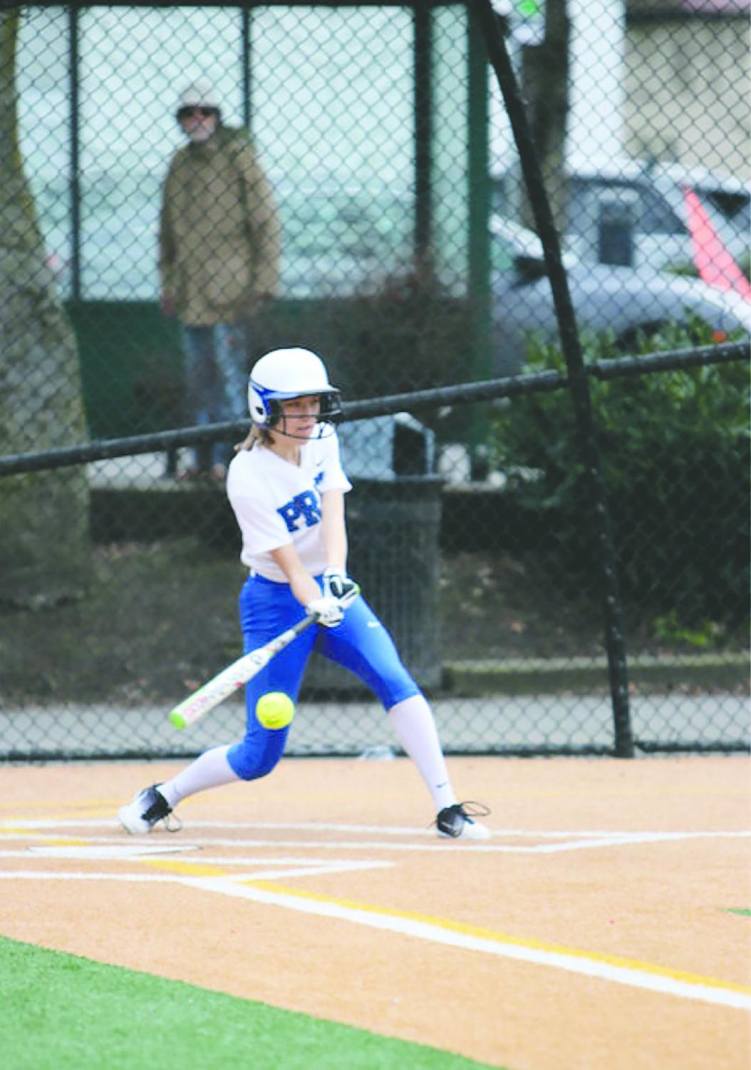 Alex Baker batting at a Seattle Prep Softball game. Baker is a two season athlete with a great batting average.