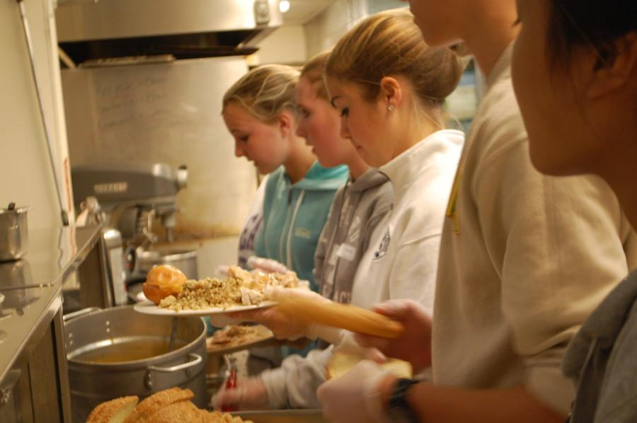 Students work at a local soup kitchen