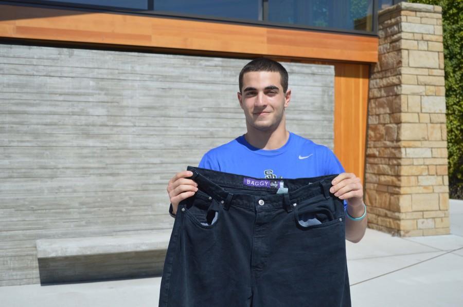 Prep alum Jonathan Khalfayan '15 poses with the prized pants of the boys' lacrosse team.