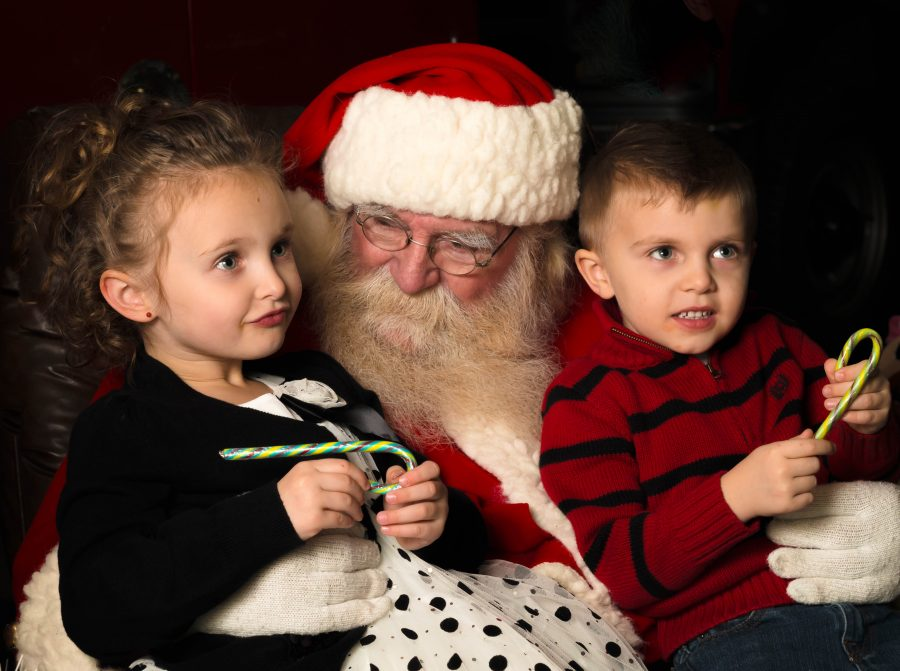 Children+asking+Santa+what+they+want+for+Christmas%2C+a+tradition+dating+back+to+the+19th+Century.