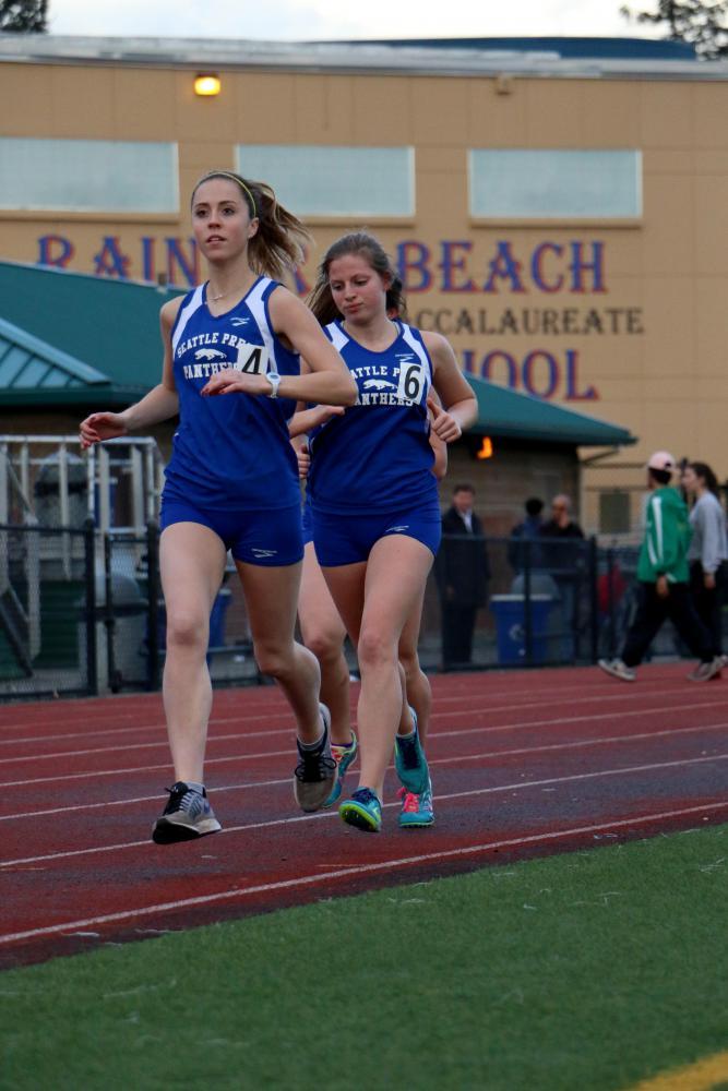 Track stars Ellie Kopf '17 and Riva Tobin '18 at Rainier Beach for a track meet. Kopf '17 will run at Santa Clara University next year.