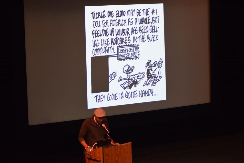 Author Keith Knight speaks to students and shows his thought provoking cartoons.