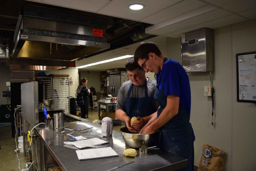 Students prepare dough in Culinary Window class. The class gives students the opportunity to learn from Prep Chef Violet and hone their cooking skills.