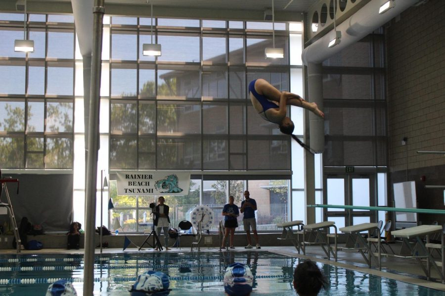Junior Kate Leahy performs a dive during a Metro League swimming and diving meet in September. Leahy and Sophomore Anastasia Greene are currently the only two divers on the newly formed Seattle Prep Dive Team.