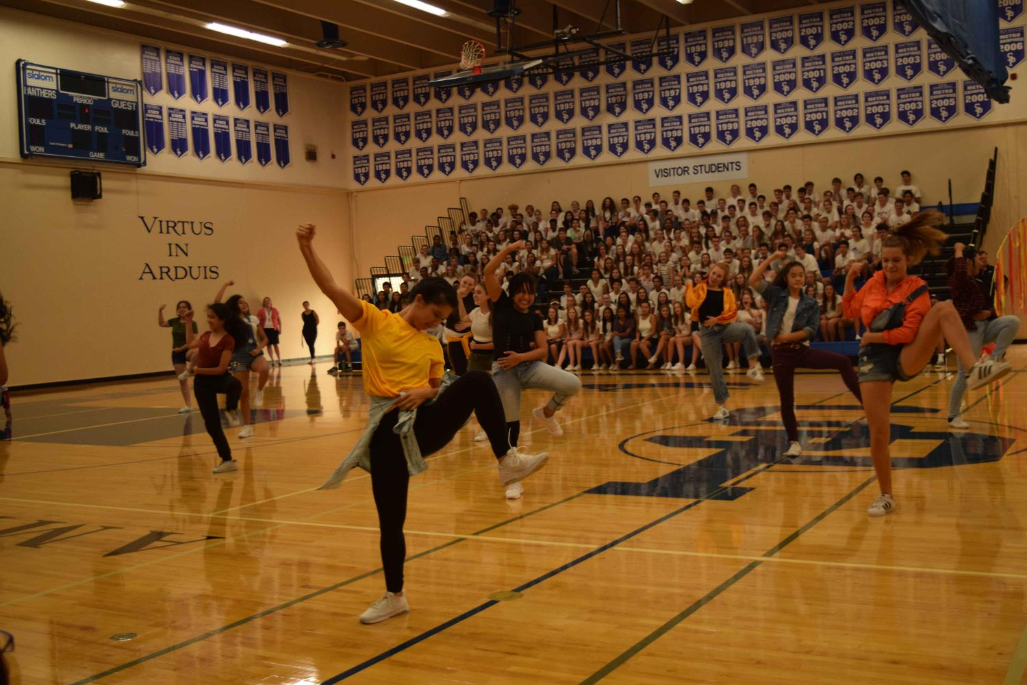 Pulse dances out their excitement st the back-to-school assembley. Leaders hope to build the team in numbers while keeping the unity of the group.