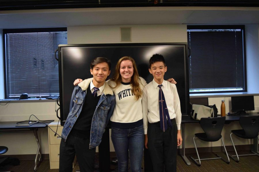Senior Annika Bjornson poses with two exchange students. Bjornson and her family hosted two exchange students from Hong Kong in October.