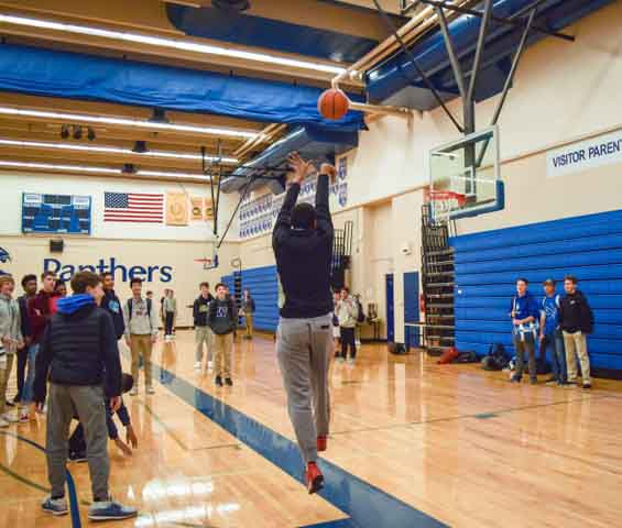 Rishi Daniels practices his jumpshot during intramurals. Intramurals gives Prep students a chance to compete on the court throughout winter.