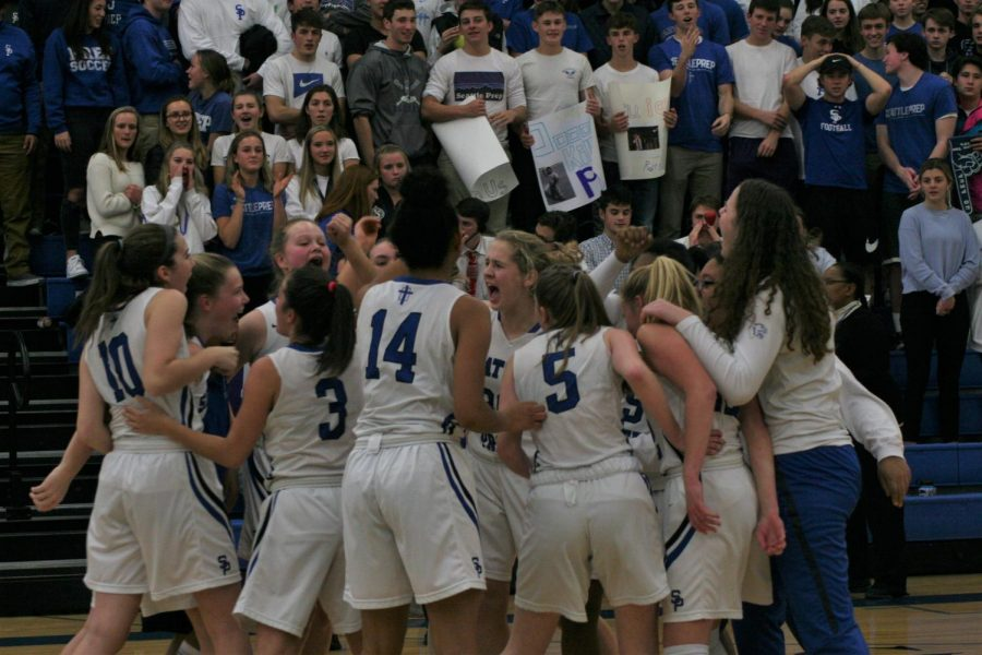 The Girls Basketball team gears up for a game. The team finished 6th overall in State.