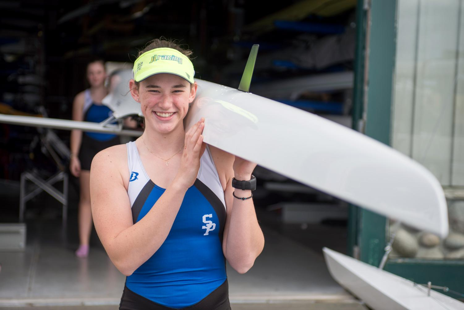 Emma Conaty carries her boat from the boat house. Conaty, who only started rowing two years ago, will be heading to WSU to pursue her rowing career.
