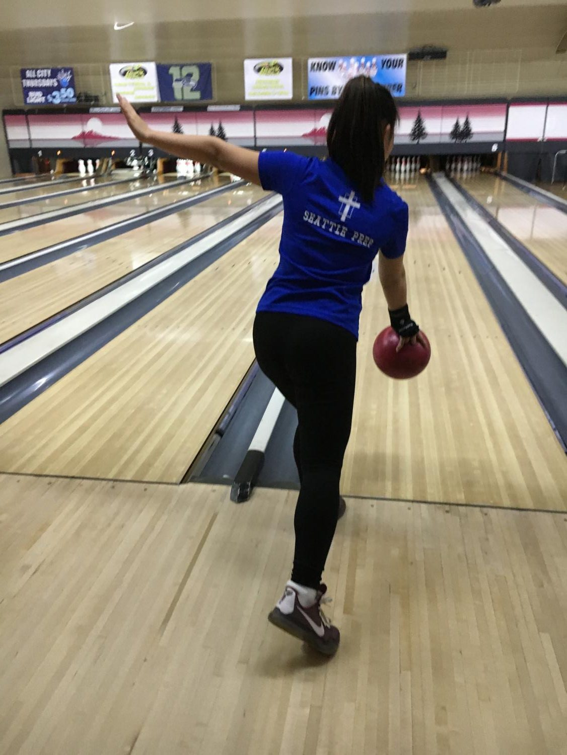Sydney Shimizu '21 bowls at a recent match. Shimizu is one of two freshmen on the team and enjoys the support of her coaches and teammates.