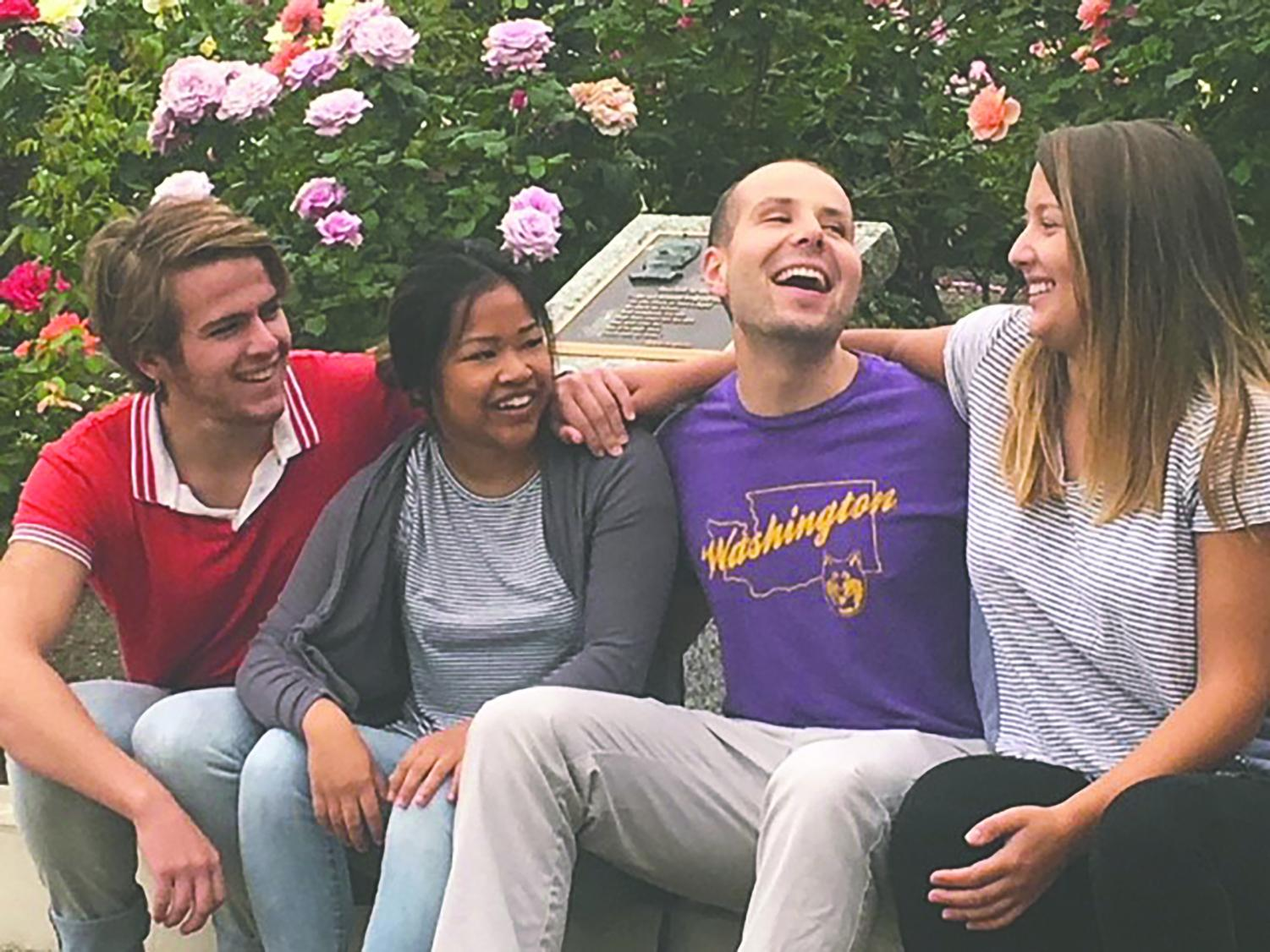 Charles Shafer, Caroline Cacabelos, Max Hanson, and Emma Johnson gather in front of the Alumni Service Corps house. This is the second year of the ASC program.