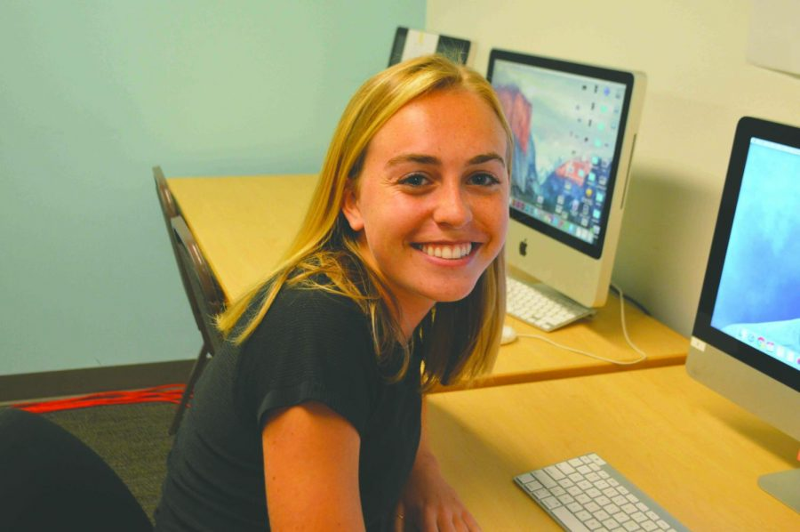 Grace Jordan '19 works in the Yearbook Room. Jordan is a star athlete and editor of the Seattle Prep Yearbook.