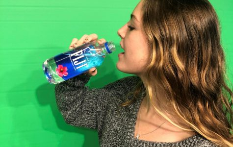 Piper Wood '21 drinking Fiji Water.