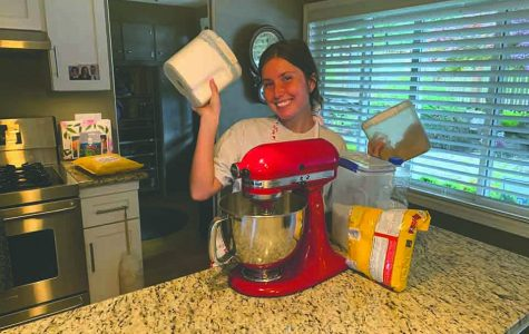 Margaret Felton '21 poses with her ingredients for chocolate chip cookies. Baking has become an essential escape for her.