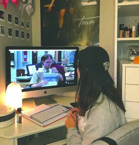 "Alianna Lugo '21, watches ""The Office"" at her home during quarantine. Watching movies and TV shows can bring people together."