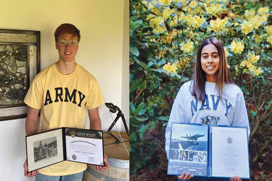 Cooper Klein '20 (left) and Maya Ghali '20 (right) hold up their acceptance packets of their respective service academies while wearing their school's merchandise to show their school pride.