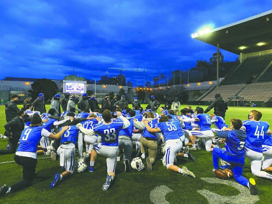Seattle Prep Football circles up following their recent win over O'Dea. It was the Panthers first win over O'Dea Football in over 40 years.