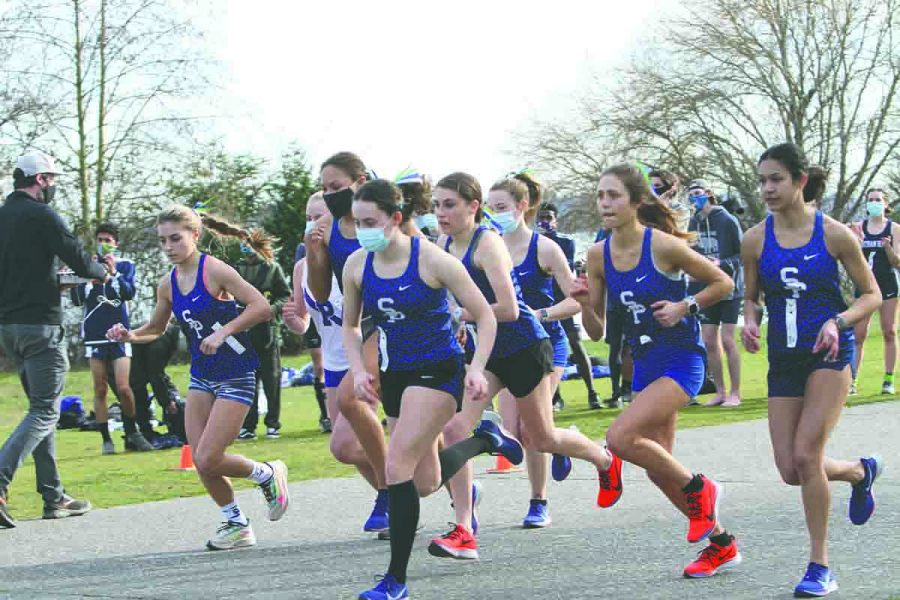 The Girls Cross Country team starts a race at Magnuson Park. The team finished first in state during Season One.