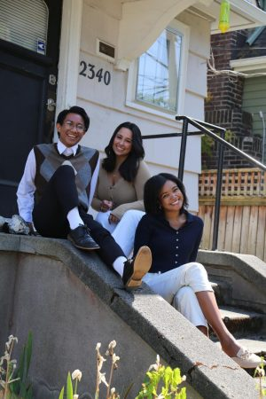 ASC members Jeffrey Pelayo, Haley Guinasso, and Alex Campbell in front of the ASC house.