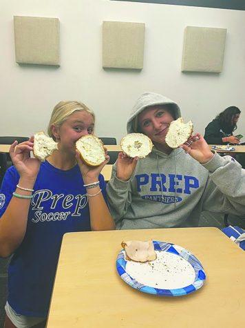 Jayce Woodward 22 and Elsa Kammerack enjoy pre-game bagels ahead of their game!