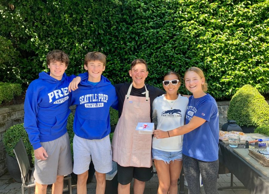 Sophomores+Brock+Tuminello+%28center%29+and+Natalia+Peng+%28right%29+at+their+summer+fundraising+barbeque.